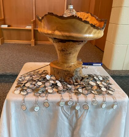 UUCV chalice with tokens on a table below
